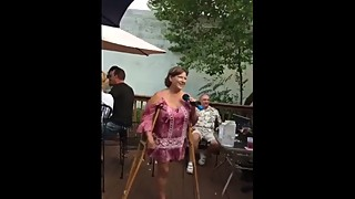 Mature LAK Amputee Lady Singing and Swinging Stump