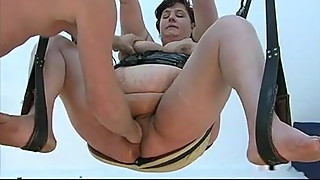 BBW mom fisted on the swing and the sofa