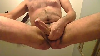 Beating big dick and swinging balls underneath view